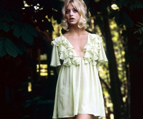 American actress Goldie Hawn posing in a short pale green dress, mid 1960s. (Photo by Terry O'Neill)